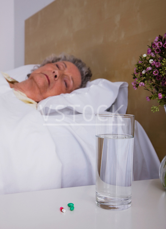 Senior woman asleep in bed