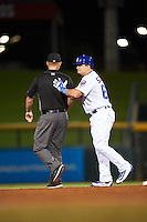 Mesa Solar Sox designated hitter Kyle Schwarber (66), of the Chicago Cubs, jokes with second base umpire Tom Woodring at the end of the eighth inning after lining out to center field during a game against the Salt River Rafters on October 22, 2016 at Sloan Park in Mesa, Arizona.  It was the first game action for Schwarber who was injured April 7th and underwent surgery to repair two ligament tears in his left knee.  Salt River defeated Mesa 7-2.  (Mike Janes/Four Seam Images)