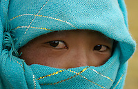 A very common practice in Tibet amongst the Nomads is to cover their face due to the intense Sunlight at high altitude, near Namtso Lake