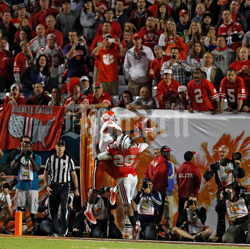 Clemson Tigers wide receiver Martavis Bryant (1) makes a catch to score a touchdown against Ohio State Buckeyes cornerback Armani Reeves (26) during the 3rd quarter in the Discover Orange Bowl at Sun Life Stadium in Miami Gardens, Florida on January 3, 2014.(Dispatch photo by Kyle Robertson)