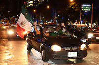 Mexico, DF November 20. 13. People celebrate the victory of the Mexican National soccer Team 4-2 against New Zealand on the streets of Mexico City. Photo by Miguel Angel Pantaleon/VIEWpress