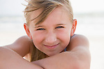 USA, Florida, St. Pete Beach, Portrait of smiling girl (8-9) on beach