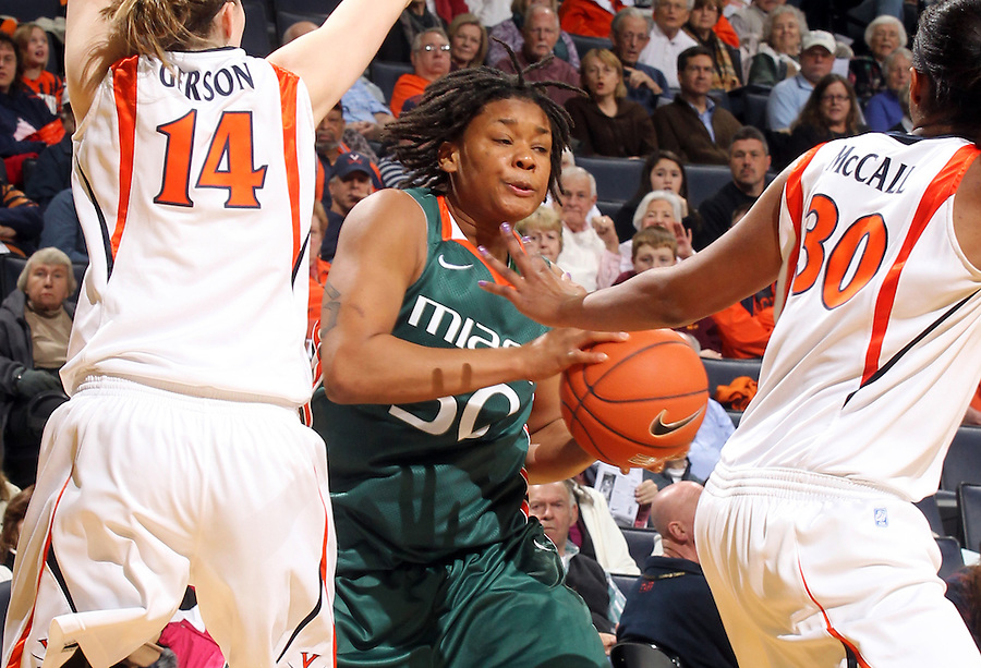 Jan. 6, 2011; Charlottesville, VA, USA; Miami Hurricanes forward Maria Brown (50) is covered up by Virginia Cavaliers guard Lexie Gerson (14) and Virginia Cavaliers forward Telia McCall (30) during the game at the John Paul Jones Arena.  Mandatory Credit: Andrew Shurtleff