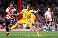 Nick Powell of Wigan Athletic shields the ball from Ezri Konsa of Brentford during Brentford vs Wigan Athletic, Sky Bet EFL Championship Football at Griffin Park on 15th September 2018