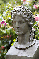 A classical head is one of several sculptures decorating the garden
