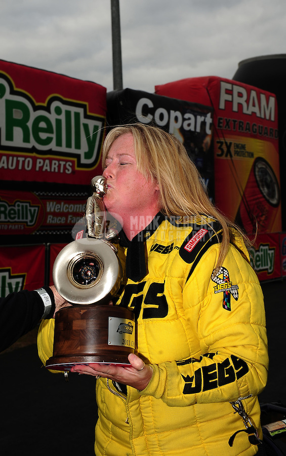 Sept. 18, 2011; Concord, NC, USA: NHRA super comp driver Michelle Furr celebrates after winning the O'Reilly Auto Parts Nationals at zMax Dragway. Mandatory Credit: Mark J. Rebilas-