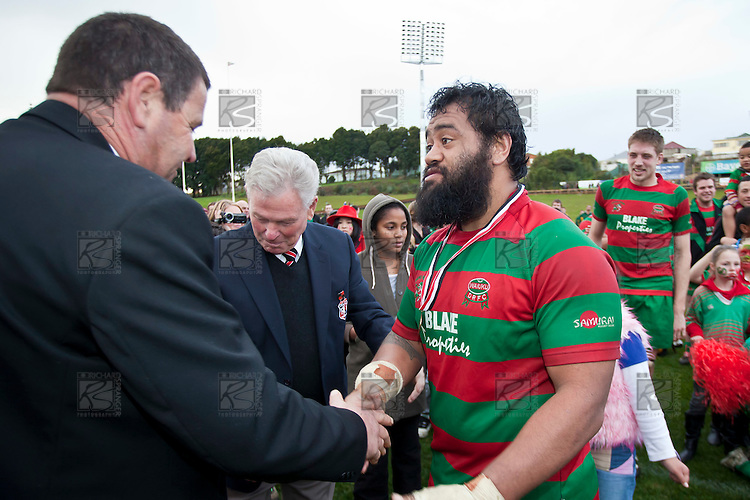 Premier club rugby top try scorer Simon Lemalu shakes hands with Dave Peden after recieving his winners medal from Henry Wilcox. Counties Manukau McNamara Cup Premier Club Rugby final between Pukekohe andWaiuku, held at Bayer Growers Stadium, on Saturday July 17th. Waiuku won 25 - 20.