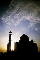 Silhouette of the Taj Mahal at sunset, Agra, India.