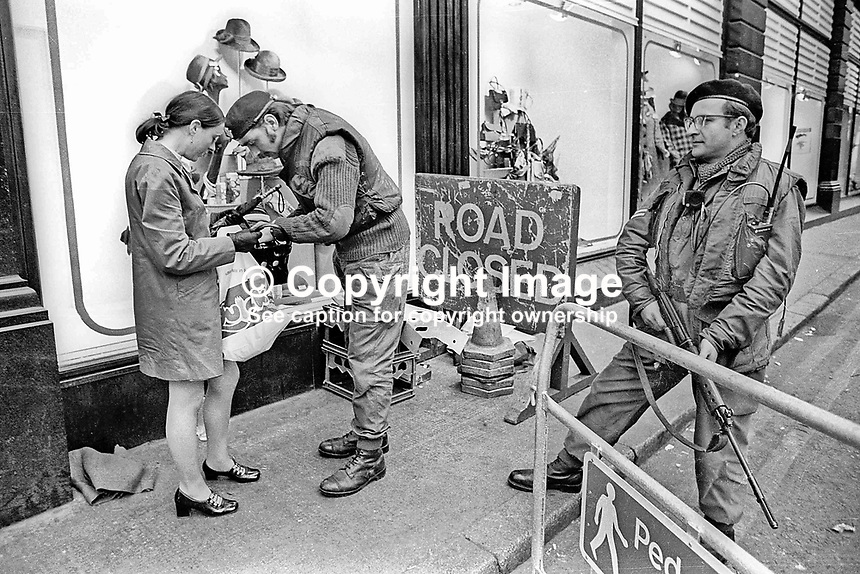 Members of the UDR, Ulster Defence Regiment, who have been called up to carry out shopper search duties in Central Belfast, N Ireland, UK. Ref: 19721020001.<br /> <br /> Copyright Image from Victor Patterson, 54 Dorchester Park, <br /> Belfast, UK, BT9 6RJ<br /> <br /> t1: +44 28 9066 1296 (from Rep of Ireland 048 9066 1296)<br /> t2: +44 28 9002 2446 (from Rep of Ireland 048 9002 2446)<br /> m: +44 7802 353836<br /> <br /> e1: victorpatterson@me.com<br /> e2: victorpatterson@gmail.com<br /> www.victorpatterson.com<br /> <br /> Please see my Terms and Conditions of Use at www.victorpatterson.com. It is IMPORTANT that you familiarise yourself with them.<br /> <br /> Images used on the Internet must be visibly watermarked i.e. &copy; Victor Patterson<br /> within the body of the image and copyright metadata must not be deleted. Images <br /> used on the Internet have a size restriction of 4kbs and will be chargeable at current<br />  NUJ rates unless agreed otherwise.<br /> <br /> This image is only available for the use of the download recipient i.e. television station, newspaper, magazine, book publisher, etc, and must not be passed on to any third <br /> party. It is also downloaded on condition that each and every usage is notified within 7 days to victorpatterson@me.com<br /> <br /> The right of Victor Patterson to be identified as the author is asserted in accordance with The Copyright Designs And Patents Act (1988).