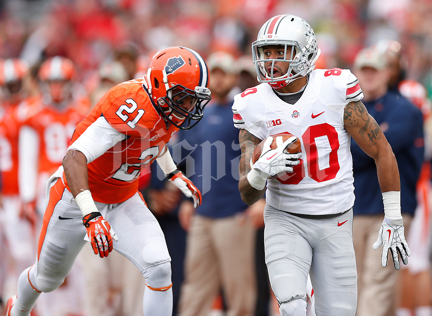 Ohio State Buckeyes wide receiver Chris Fields (80) is chased by Illinois Fighting Illini defensive back Zane Petty (21) during the second half of Saturday's NCAA Division I football game at Memorial Stadium in Champaign, Il., on November 16, 2013. Ohio State won the game 60-35. (Barbara J. Perenic/The Columbus Dispatch)