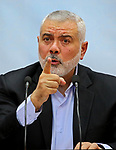 "(FILES) In this file photo taken on January 23, 2018 Hamas' leader Ismail Haniya delivers a speech in Gaza city. The United States on January 31, 2018 put the head of Palestinian Islamist movement Hamas, Ismail Haniya, on its terror blacklist and slapped sanctions on him -- a move sure to raise tensions, after Washington recognized Jerusalem as Israel's capital.""Haniya has close links with Hamas' military wing and has been a proponent of armed struggle, including against civilians,"" the State Department said in a statement.. Photo by Ashraf Amra"