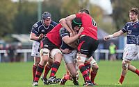 James Hallam of London Scottish is stopped during the Greene King IPA Championship match between London Scottish Football Club and Jersey at Richmond Athletic Ground, Richmond, United Kingdom on 7 November 2015. Photo by Andy Rowland.