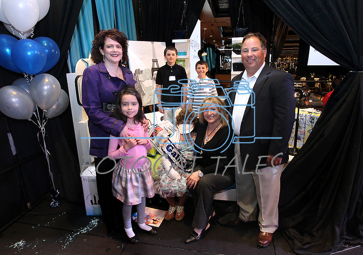 The Gouldsmith family poses with Nevada First Lady Kathleen Sandoval and her daughter Marisa, left, following the Make-A-Wish Foundation Waffles & Wishes event at the Atlantis Casino Resort, in Reno, Nev., on Tuesday, March 27, 2012. Gabby Gouldsmith, 8, center, who suffers from an auto-immune deficiency disorder, received a bedroom makeover from the organization. .Photo by Cathleen Allison