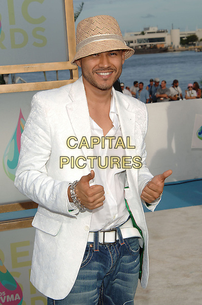 FRANKIE J.MTV Video Music Awards.Arrivals held at the American Airlines Arena,.Miami, 28th August 2005.half length white jacket shirt hat thumbs hands goatie beard.Ref: ADM/JW.www.capitalpictures.com.sales@capitalpictures.com.© Capital Pictures.v-neck plunging neckline