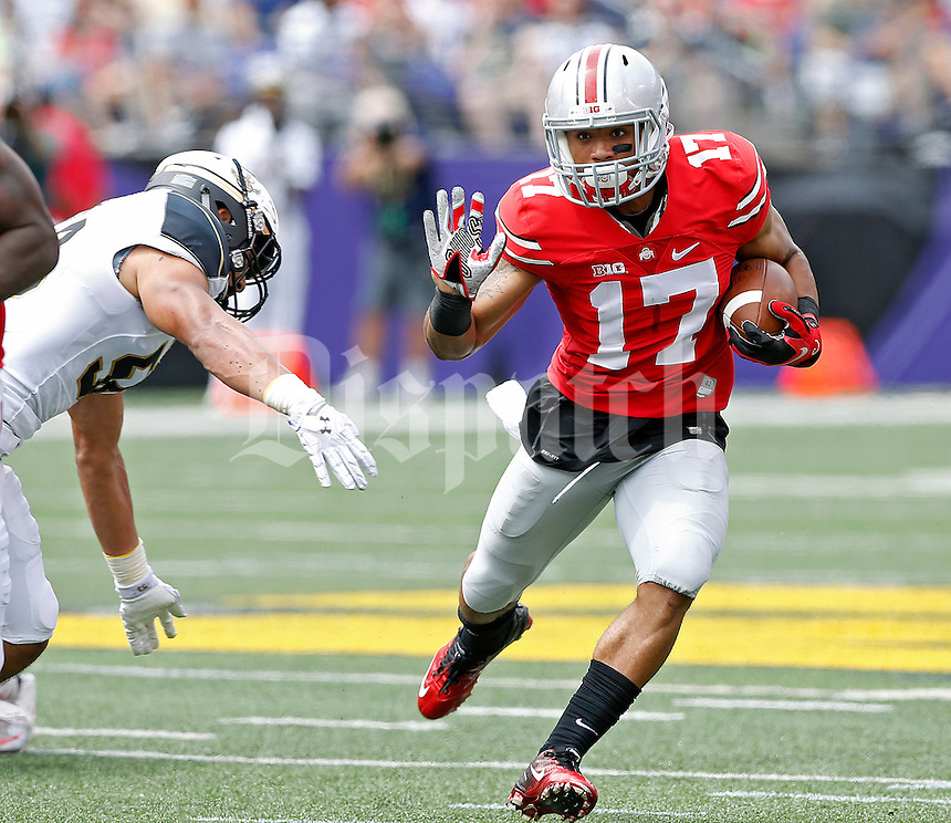 Ohio State Buckeyes running back Jalin Marshall (17) carries the ball up field against Navy Midshipmen in the 1st quarter of their NCAA game at M&T Bank Stadium in Baltimore, Maryland on August 30, 2014. (Dispatch photo by Kyle Robertson)