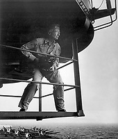 Edward J. Steichen, photographic expert, on island platform, studies his surrounding for one of his outstanding photographs of life aboard an aircraft carrier.  Steichen held the rank of Comdr. at this time. Ca.  Attributed to Lt. Victor Jorgensen. (Navy)<br /> Exact Date Shot Unknown<br /> NARA FILE #:  080-G-324556<br /> WAR &amp; CONFLICT #:  759