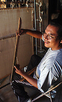 "Hopi weaver James Poley learned on his uncle's upright weaving loom. It was that same loom he inherited as tools are passed down thru the clan only men are weavers and they pass the skill to down to their nephews. Poley hold one tool he believes to be at least 300 years old.  He handles.it real gingerly since he believe if it would fall, it.perhaps might shatter. The batten is known as a ""sukua"" in Hopi."