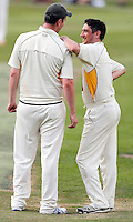Tom Wakeford (R) of North London shares a joke with Jack Atchinson during the Middlesex County Cricket League Division Three game between North London and Brentham at Park Road, London, on Sat July 23, 2016