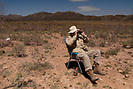 Minuteman Project volunteer Bob Dolan of Florida monitors the US/Mexico border fence near Naco, Arizona on Monday, April 4, 2005. The Minuteman Project is an all-volunteer group monitoring the US/Mexico border in Arizona for the month of April, reporting all illegal border crossers to the US Border Patrol.<br />
