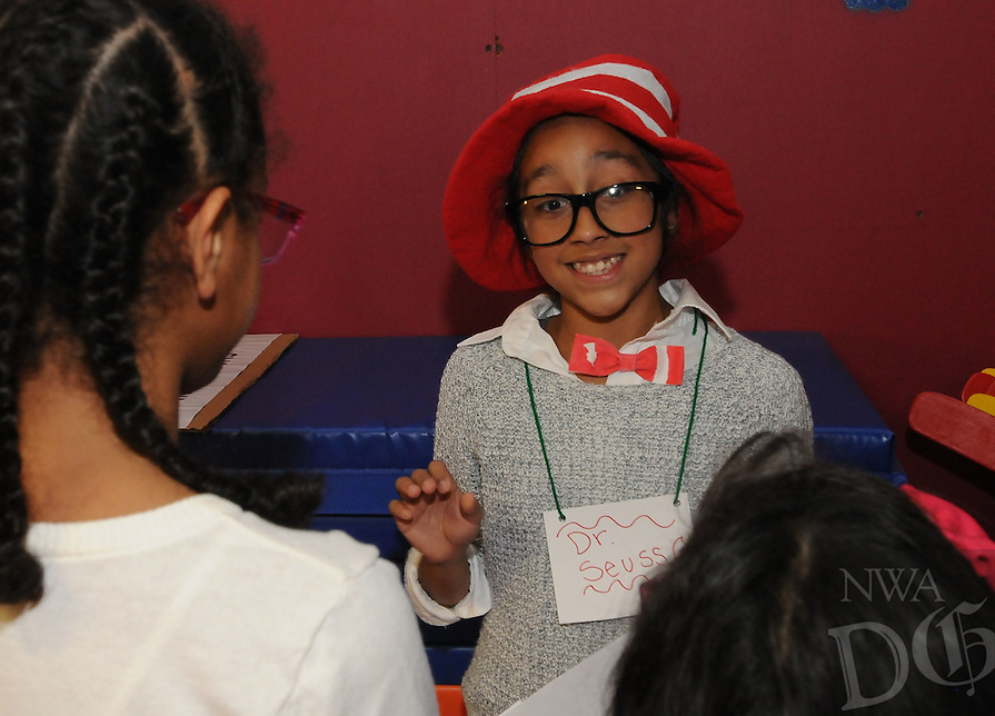 NWA Democrat-Gazette/FLIP PUTTHOFF <br /> RESEARCHING HISTORY<br /> Gabby Vite plays Dr. Seuss during a living history program Elmwood students presented Tuesday Nov. 10, 2015 at Bonnie Grimes Elementary. Sixth-grade students in the Elmwood REACH program researched a well-known person from history, then dressed the part and recited their character's story to Grimes students. Elmwood students spent one month reading books and creating a poster and display about their chosen character, said Candice Duncan, REACH teacher at Elmwood. Characters included political figures, military personnel and athletes.