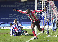 .Photo Peter Spurrier.06/04/2002.Nationwide Div 2.Brentford vs Huddersfield - Griffen Park:.Lloyd Owusu, celbrates his first goal...