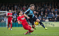 Mathieu Baudry of Leyton Orient tackles Garry Thompson of Wycombe Wanderers during the Sky Bet League 2 match between Wycombe Wanderers and Leyton Orient at Adams Park, High Wycombe, England on 23 January 2016. Photo by Andy Rowland / PRiME Media Images.