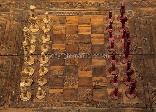 A chess set with inlaid board, 15th century, from the collection of the Crespo Lopez family exhibited in the 16th century Palacio de los Olvidados or Palace of the Forgotten, in El Albayzin, the medieval Moorish old town of Granada, Andalusia, Southern Spain. The Palace is one of the few remaining old aristocratic houses in good condition, thought to belong to a Jew and now housing artefacts of Jewish culture and history. Granada was listed as a UNESCO World Heritage Site in 1984. Picture by Manuel Cohen