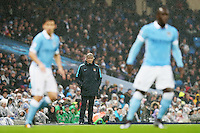 Manchester city manager Manuel Pellegrini looks on during the Barclays Premier League Match between Manchester City and Swansea City played at the Etihad Stadium, Manchester on 12th December 2015