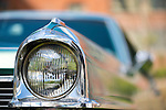 Floral Park, New York, U.S. - April 27, 2014 -  A headlight detail of a 1965 Cadillac Calais luxury classic car exhibited at the 35th Annual Antique Auto Show at Queens Farm.