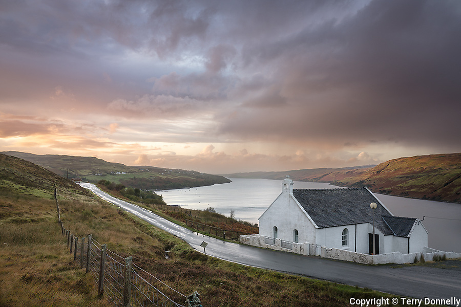 Carbost, Isle of Skye, Scotland:<br /> Church and clearing storm at dusk, Loch Harport