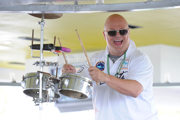 Michael Chiklis seen playing the bongos at a local Miami Beach bar  in Miami, Florida. January 1, 2011. © MediaPunch Inc. / MPI04