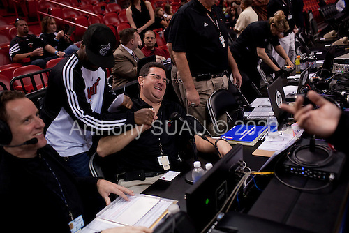 Miami, Florida<br /> January 29, 2012<br /> <br /> Miami HEAT public address announcer Michael Baiamonte, sits court side and jokes with friends just minutes before the game between the Chicago Bulls and Miami Heat.