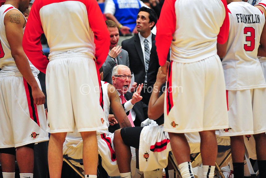 Mar 19, 2011; Tucson, AZ, USA; San Diego State Aztecs head coach Steve Fisher talks to his team late in the second half of a game against the Temple Owls in the third round of the 2011 NCAA men's basketball tournament at the McKale Center.  The Aztecs won 71-64 in double overtime.