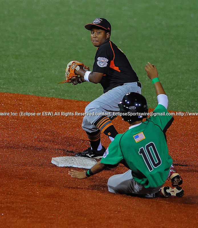 Bronx(NY)'s Jordy Toribio tries to turn a double play during the Cal Ripken Babe Ruth World Series in Aberdeen, Maryland on August 17, 2012. The Bronx defeated Mililanii 9-8 in nine innings.