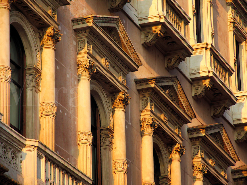 Colmuned facade of Galleria Vittorio Emanuele, Milan, Ital