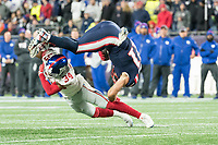 FOXBORO, MA - OCTOBER 10: New York Giants Cornerback Grant Haley (34) tackles New England Patriots Wide Receiver Julian Edelman (11) after a catch during a game between New York Giants and New England Patriots at Gillettes on October 10, 2019 in Foxboro, Massachusetts.