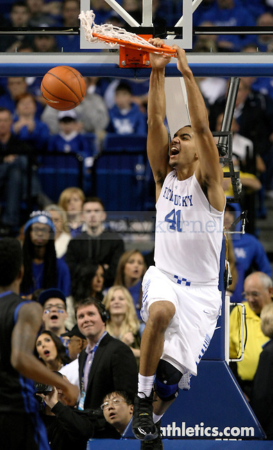 UK freshman forward Trey Lyles (41) dunks the ball during the second half of the University of Kentucky vs. State University of New York at Buffalo men's basketball game at Rupp Arena in Lexington, Ky., on Sunday, November 16, 2014. UK won 71-52. Photo by Tessa Lighty | Staff