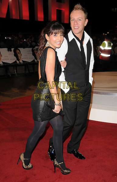 "ROXANNE PALLETT & GUEST .Attending the UK Film Premiere of ""Seven Pounds"" at the Empire Cinema, Leicester Square, London, England, January 14th 2009..full length black dress shiny tights leopard print shoes peep toe mary janes waistcoat white shirt clutch bag.CAP/CAS.©Bob Cass/Capital Pictures"