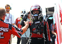 Aug. 1, 2014; Kent, WA, USA; NHRA funny car driver Courtney Force fist bumps a crew member during qualifying for the Northwest Nationals at Pacific Raceways. Mandatory Credit: Mark J. Rebilas-USA TODAY Sports