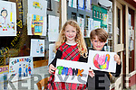 LAuren and Joshua O'Sullivan with some of the art pictures the children have drawn to thanks the front line staff and are being displayed in Caragh Restaurant Killarney