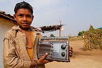 INDIA, Madhya Pradesh , boy with radio in village