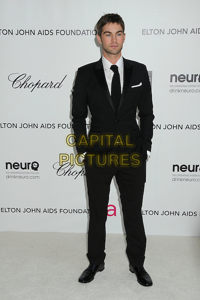 Chace Crawford.20th Annual Elton John Academy Awards Viewing Party held at West Hollywood Park, West Hollywood, California, USA..February 26th, 2012.full length black suit hands in pockets .CAP/ADM/BP.©Byron Purvis/AdMedia/Capital Pictures.