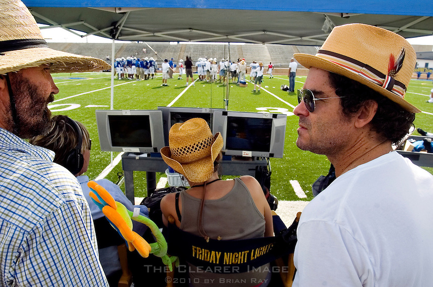 Directory of Photography David Boyd (left) (CQ) and Executive Producer Jeffrey Reiner (right) (CQ) discuss a scene of the Friday Night Lights television show behind the director's tent during a filming session at Herrmann Field in Pflugerville, TX on Sunday, August 28, 2006.