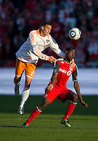 07 May 2011: Houston Dynamo midfielder Geoff Cameron #20 and Toronto FC midfielder Tony Tchani #22 in action during an MLS game between the Houston Dynamo and the Toronto FC at BMO Field in Toronto, Ontario..Toronto FC won 2-1.
