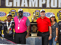 Oct 30, 2016; Las Vegas, NV, USA; NHRA top fuel driver Antron Brown celebrates with Toyota Racing personnel after clicking championship during the Toyota Nationals at The Strip at Las Vegas Motor Speedway. Mandatory Credit: Mark J. Rebilas-USA TODAY Sports