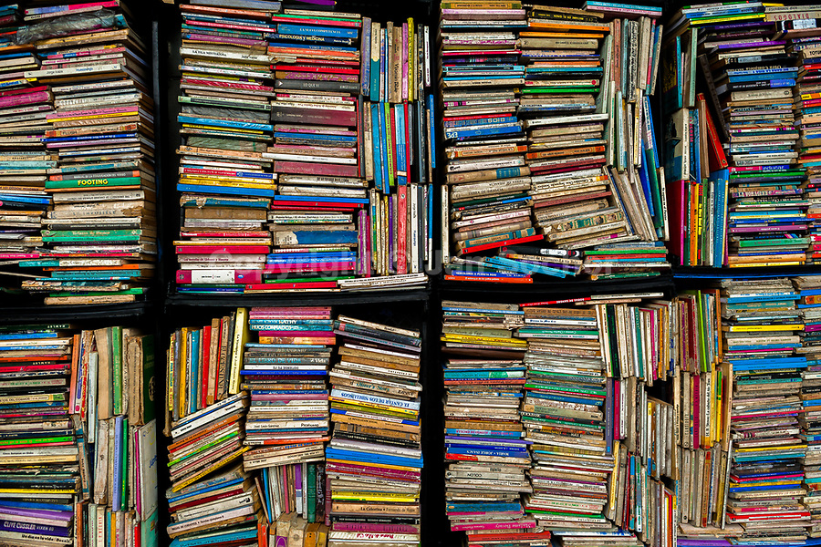 Hundreds of used books are seen stacked in boxes on the street in a secondhand bookshop in San Salvador, El Salvador, 12 April 2018. Large collections of worn-out books, mostly textbooks and educational paperbacks, are sold regularly in secondhand bookshops in the center of the city.