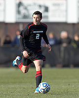 Northeastern University midfielder/defender Laurence Braude (2) brings the ball forward. .NCAA Tournament. University of Connecticut (white) defeated Northeastern University (black), 1-0, at Morrone Stadium at University of Connecticut on November 18, 2012.