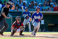 Pratt Maynard #18 of the Rancho Cucamonga Quakes bats against the Lancaster JetHawks while being watched by Umpire Luke Engen and JetHawks catcher Tyler Heineman #26 during a game at The Hanger on August 25, 2013 in Lancaster, California. Lancaster defeated Rancho Cucamonga, 7-1. (Larry Goren/Four Seam Images)