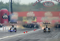 Sept. 1, 2012; Claremont, IN, USA: NHRA top fuel dragster driver Troy Buff (right) races alongside XXXX during qualifying for the US Nationals at Lucas Oil Raceway. Mandatory Credit: Mark J. Rebilas-