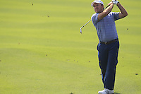 Richard Sterne (RSA) plays his 2nd shot on the 9th hole during Sunday's Final Round of the 2014 BMW Masters held at Lake Malaren, Shanghai, China. 2nd November 2014.<br /> Picture: Eoin Clarke www.golffile.ie